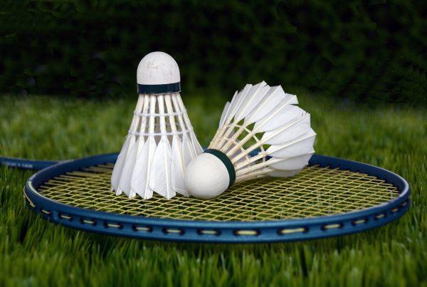 badminton rackets shuttlecocks field